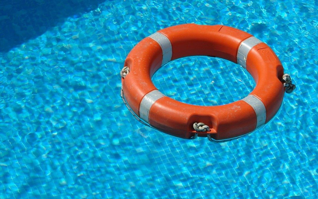 keep a flotation device nearby for swimming pool safety
